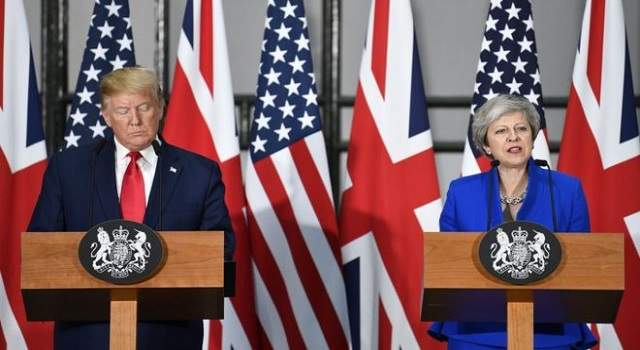 trum iyo theresa may